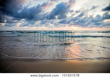 Cloudy sunset on the tropical beach