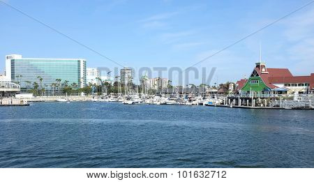 LONG BEACH, CA - FEBRUARY 21, 2015: Shoreline Village at Rainbow Harbor. The harbor and village is a popular family friendly destinations for tourists and locals.