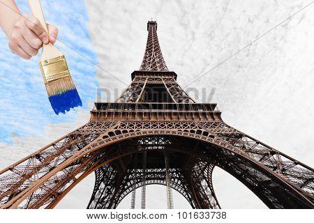 Paintbrush Paints Blue Sky Over Eiffel Tower
