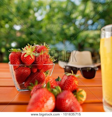 Red Ripe Strawberry And Juice On The Table