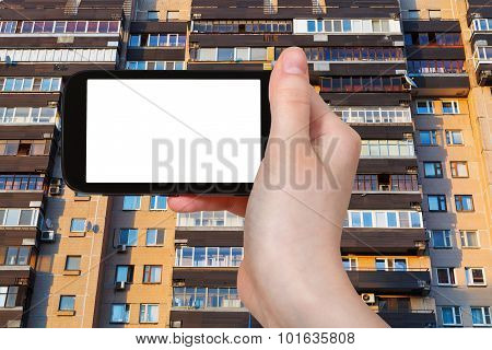 Smartphone And Facade On Appartment House