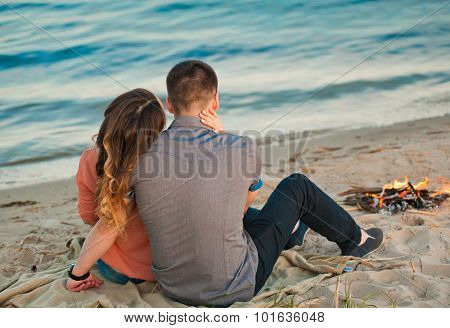 Loving couple sitting on the beach