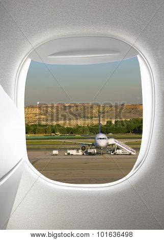 Plane window with airfield