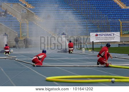 ST. PETERSBURG, RUSSIA - SEPTEMBER 9, 2015: Team Poland during competitions in combat deployment during the XI World Championship in Fire and Rescue Sport. First World Championship was held in 2002