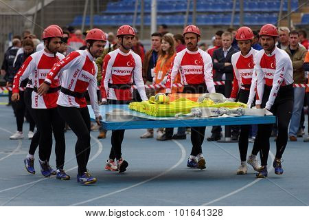 ST. PETERSBURG, RUSSIA - SEPTEMBER 9, 2015: Team Turkey bring fire hoses before competitions in combat deployment during XI World Championship in Fire and Rescue Sport