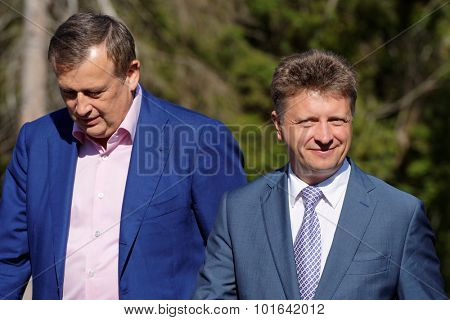NOVOPRIOZERSK HIGHWAY, LENINGRAD OBLAST, RUSSIA - SEPTEMBER 11, 2015: Minister of transport M. Sokolov (right) and governor or Leningrad oblast A.Drozdenko during the opening of new stretch of highway