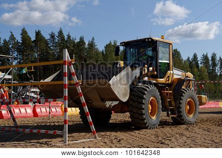 NOVOPRIOZERSK HIGHWAY, LENINGRAD OBLAST, RUSSIA - SEPTEMBER 11, 2015: Wheel loader competitions during the final of championship Worldskills Russia  of road workers