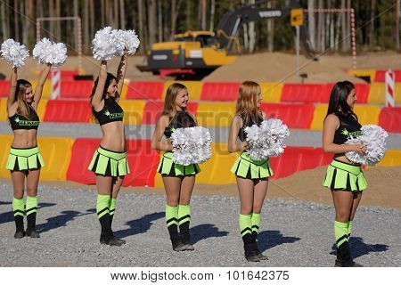 NOVOPRIOZERSK HIGHWAY, LENINGRAD OBLAST, RUSSIA - SEPTEMBER 11, 2015: Female dancers performs during award ceremony of the final part of Worldskills Russia championship among road workers