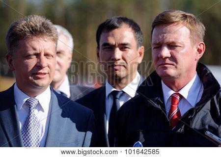 NOVOPRIOZERSK HIGHWAY, LENINGRAD OBLAST, RUSSIA - SEPTEMBER 11, 2015: Minister of transport M. Sokolov (left) and Head of Rosavtodor R. Starovoit (right) during the opening of new stretch of highway