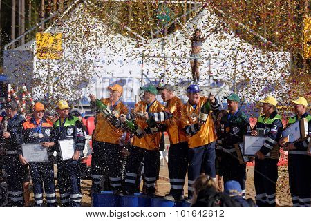 NOVOPRIOZERSK HIGHWAY, LENINGRAD OBLAST, RUSSIA - SEPTEMBER 11, 2015: Winners with prizes during award ceremony of the final part of Worldskills Russia championship among road workers