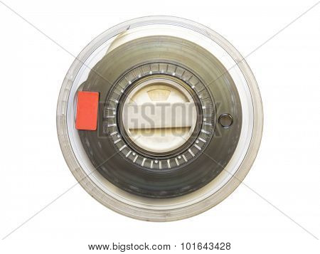 Vintage magnetic tape reel for computer data storage isolated on white background