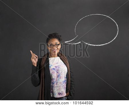 African Woman Good Idea And Speech Bubble On Blackboard Background