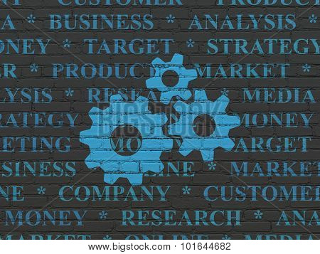 Advertising concept: Gears on wall background