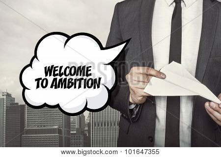 Welcome to ambition text on speech bubble with businessman holding paper plane in hand