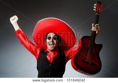 Mexican guitar player in red