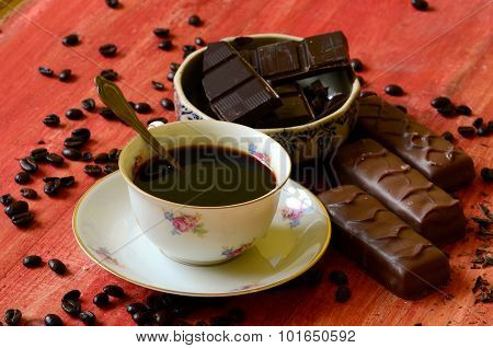 Different chocolate bars and coffee beans and peels of chocolate