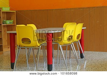 Classroom With Desks And Yellow Chairs Without Kids