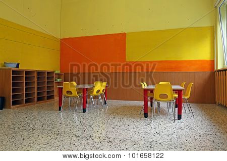 Kindergarten Classroom With Desks And Yellow Chairs