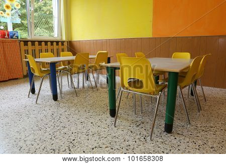Kindergarten Classroom With Desks And Yellow Chairs Without Kids