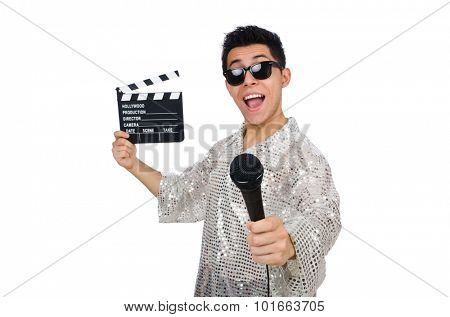 Young man with microphone and clapperboard isolated on white