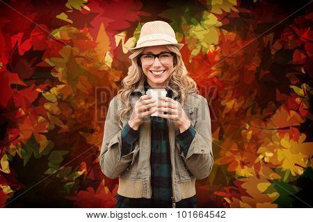 Pretty blonde against autumnal leaf pattern in warm tones