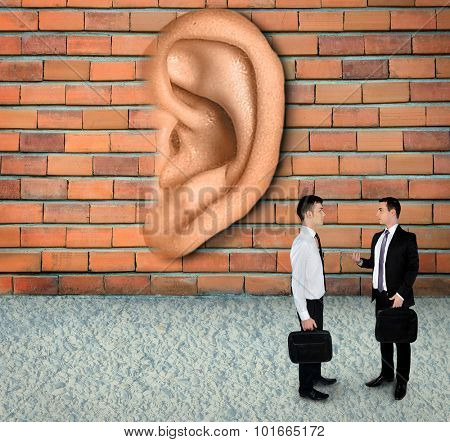 Wall have ears concept listening business meeting