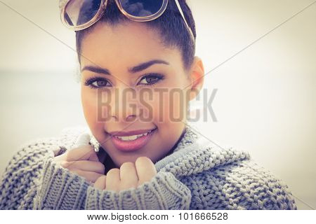 Attractive woman wearing a warm cardigan at the beach