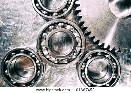 ball-bearings and gears, titanium and steel aerospace parts