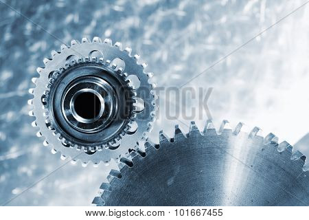 cogwheels and gears, titanium and steel against brushed aluminum, blue toning concept