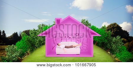 Well dressed young woman sleeping on sofa against green field