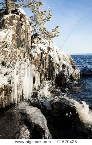 Frozen lakefront rock cliff