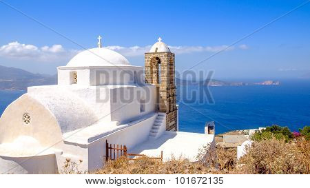 Panoramic View Of Traditional Greek Cycladic Church And Sea