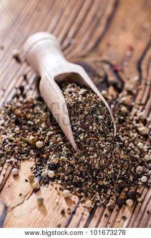 Crushed Peppercorns On A Wooden Spoon