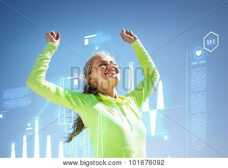 sport and lifestyle concept - woman runner celebrating victory