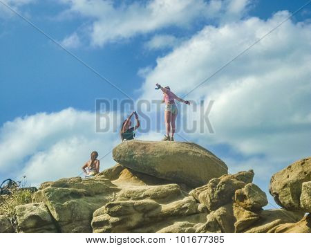 Group Of Girls Having Fun At The Top Of A Rock