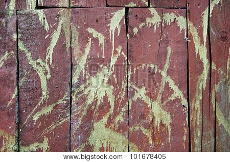 Golden Paint On Red Wooden Wall Background
