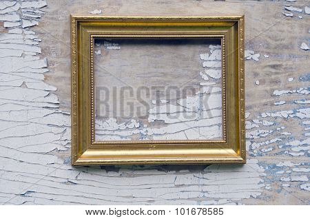 Empty Golden Frame  On Background With Peeling Paints