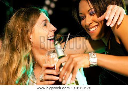 Friends having drinks in bar or club
