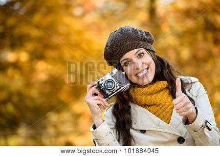 Woman With Camera In Autumn Taking Photo