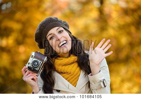 Happy Woman In Autumn Waving