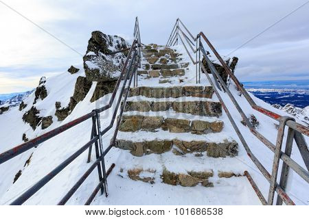 Stairs to mountain top in winter time