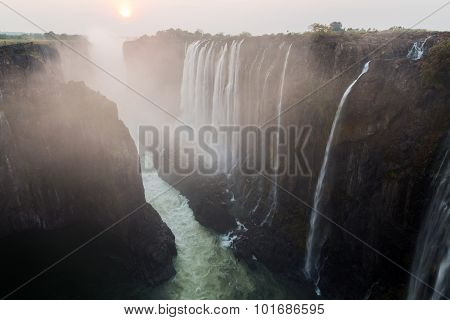 Victoria Falls from Zambia side at dusk with mist