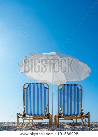 Sun bed and umbrella at the beach