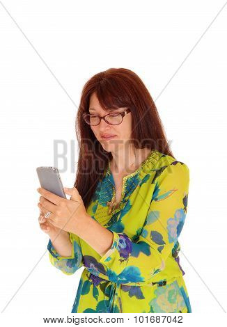 Businesswoman Looking At Cell Phone.