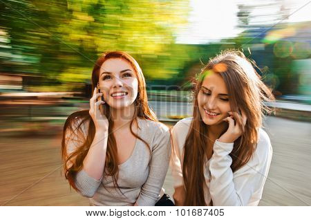 girl friends talking with phone