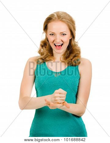 Exited young woman kicks air clenched fists arm
