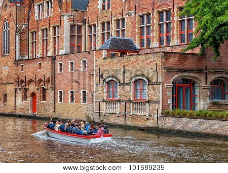 Boat tour on medieval canals of Bruges, Belgium