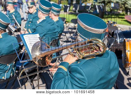 Musician Brass Band Playing The Trombone On A Sunny Day