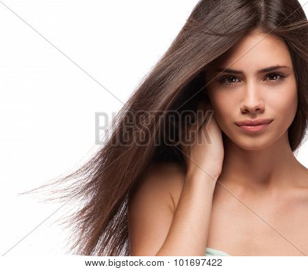 Beautiful Woman With Long Brown Hair. Closeup Portrait Of A Fashion Model Posing At Studio.