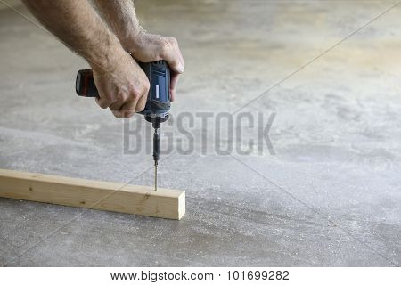 Close-up of Man Using Power Drill